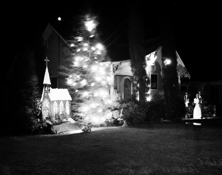 Illuminated tree outside the home of Mabel  Lay on E. Whittier Street, 1940.  (MS 359:  L-2626-K)