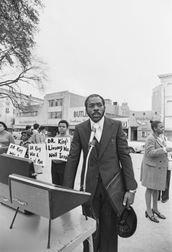 Rev. R. A. Callies, pastor of the Christian Fellowship Baptist Church, addresses gathering on Alamo Plaza following a memorial procession on the anniversary of Dr. King's birthday, January 15, 1978. (MS 360: E-0043-116-28)