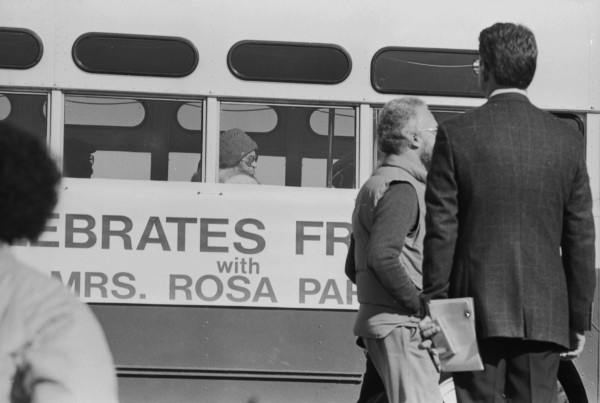 Civil rights pioneer Rosa Parks rides a vintage city bus in the first annual city-sponsored Martin Luther King Jr. Freedom March, January 19, 1987. (MS 360-1-19A-35)