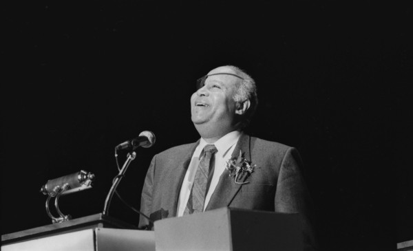 James L. Farmer, Jr., co-founder of the Congress of Racial Equality, speaks at MLK Achievement Award Ceremonies, January 18, 1988. (E-1988-1-18C-42)