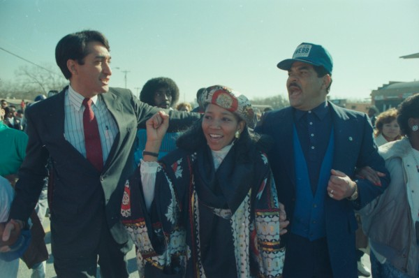 Nomonde Ngubu, organizer of mine workers in South Africa, walks with S.A. Mayor Henry Cisneros (left) and Councilman Joe Webb in the Freedom March, January 16, 1989. (MS 360: E-1989-1-16A-19)
