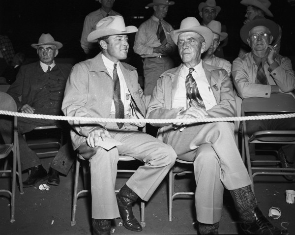 King Ranch representatives Dick Kleberg and father, Richard Kleberg, at the auction sale.  (MS 359:  L-3915-A)