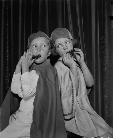 Fred Mueller and Martha McMurry, members of the harmonica band of Alamo Heights Elementary School, November  1934.  (MS 359:  L-0408-D)