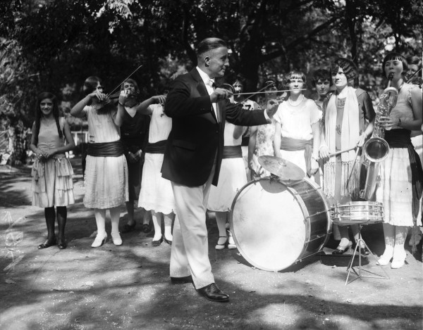 Otto Zoeller, director of music for San Antonio public high schools, conducts practice session shortly before his high school symphony orchestra played for a radio exposition, 1926.  (MS 359:  L-0481-A)