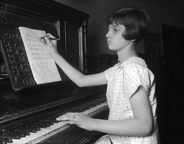 Florence Brown, student at Page Junior School, with music she composed for operetta that was performed at her school, April 1926.  (MS 359:  L-0575-J)