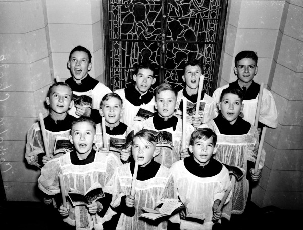 Central Catholic High School choir members sing Christmas carols at various locations in the downtown area, December 1939.  (MS 359:  L-2319-E)