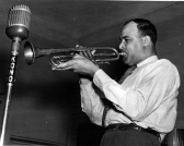Don Albert playing his trumpet into the KONO radio microphone, 19##, MS 362