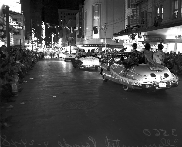 Decorated convertibles going west on E. Houston Street.  (MS 359:  L-3560-D-3)