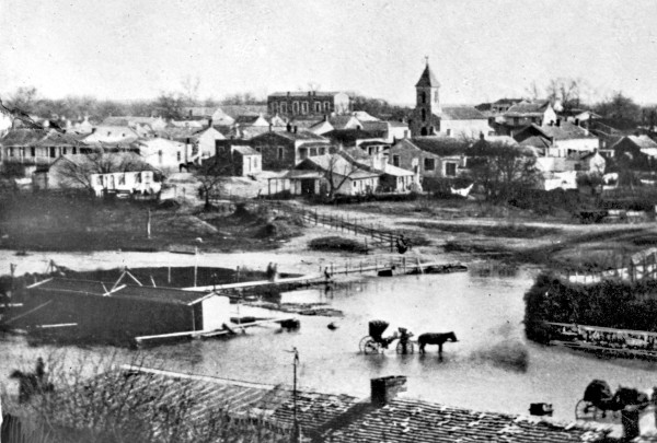 La Villita (to the left of St. John's Lutheran Church) when it was a middle-class residential neighborhood, circa 1876.  (MS 362: 082-0130)