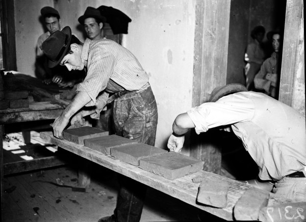 National Youth Administration (NYA) workers form bricks for the streets and walkways of La Villita, December 1939.  (MS 359: L-2317-H)