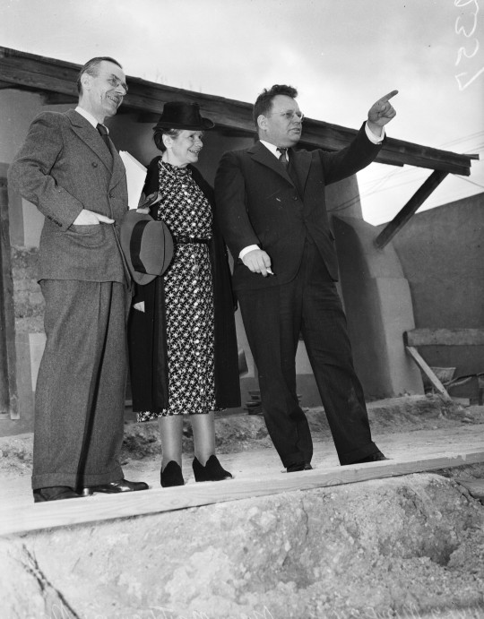 Mayor Maury Maverick (right) gives novelist Thomas Mann and his wife a tour of the La Villita restoration project, February 1940.  (MS 359: L-2357-A)