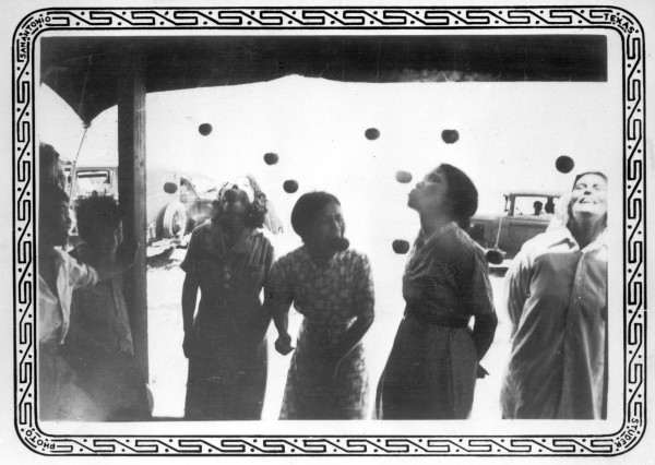 Bobbing for apples at annual picnic of the Japanese-American residents of the Rio Grande Valley, Boca Chica, June 1937.  (MS 362:  086-0349)