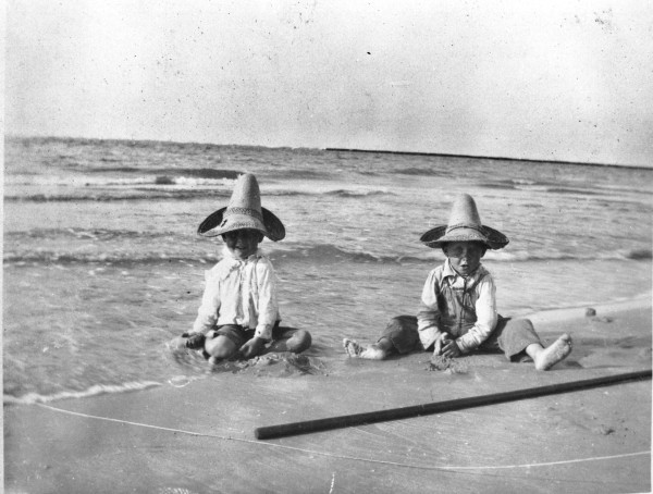 Robert and Atlee Ayres, from San Antonio, play in the sand on gulf beach near Port Aransas, c. 1902.  (MS 362:  089-0018)