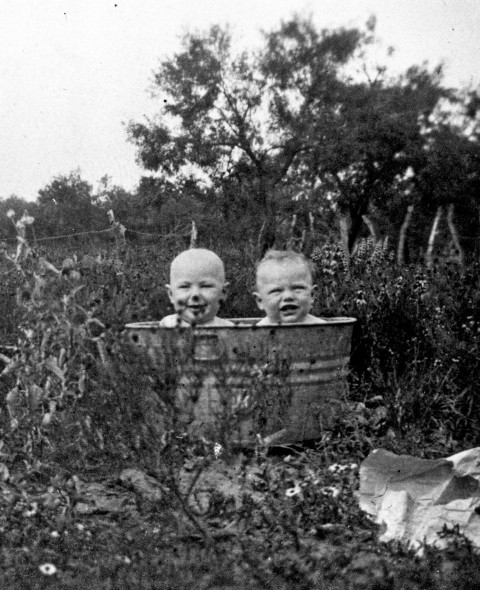 Toddlers cool off in a galvanized wash tub, Somerset, c. 1918.  (MS 362: 093-332)