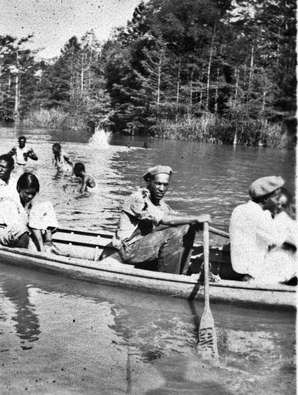 Residents of Marshall in canoe on Caddo Lake, c. 1937.  (MS 362:  093-0440)