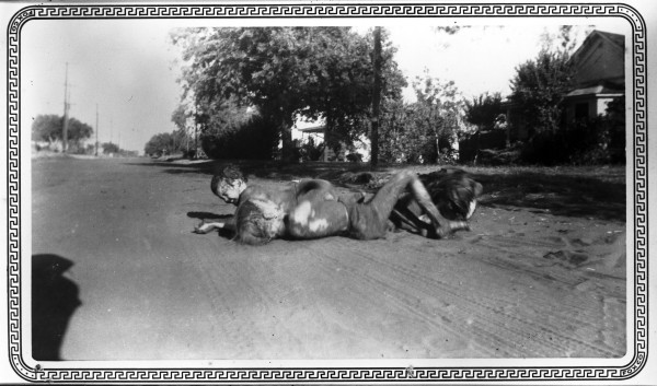 Three girls roll on unpaved street in Dilley, 1951.  (MS 362:  096-1258)