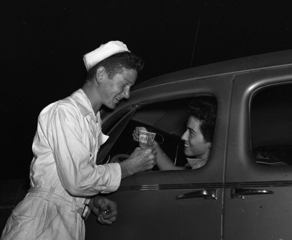 Lee Marshall, carhop, receives payment from Myrtle Bridges, May 1948.  (MS 359:  L-3571-I)
