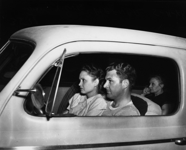 Eva and Jack Hefner and their guest watch movie on what was then the largest motion picture screen in Texas, San Pedro Outdoor Theatre, May 1948.  (MS 359:  L-3571-K)