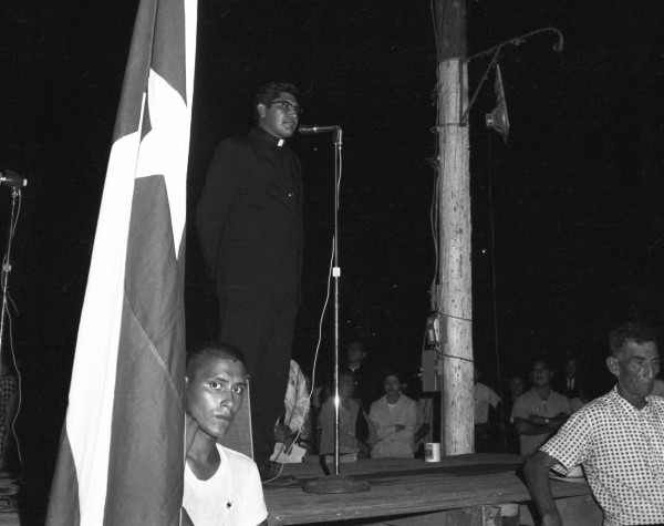 Rev. Antonio Gonzales, priest at Immaculate Heart of Mary Catholic Church in Houston and co-chairman of the march, speaking at a rally of about 500 people outside the Wilson County Courthouse, Floresville, August 23, 1966.  (MS 360: E-0012-187-A-35)