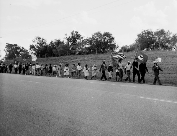 Rev. James Novarro, pastor of Kashmere Baptist Temple in Houston and co-chairman of the march, leads the other marchers along U. S. Highway 181 near Floresville, August 24, 1966.  (MS 360: E-0012-187-B-01)