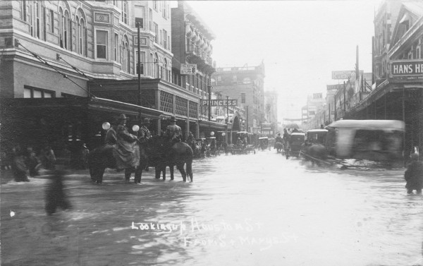 Cavalry soldiers in floodwaters that again covered E. Houston Street at the intersection of St. Mary's Street, December 1913.  (MS 362:  097-0863)