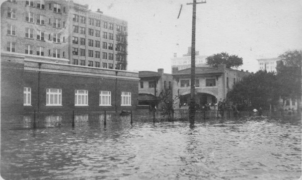 Looking southwest from Travis Street toward St. Mary's Street, October 1913.  The Gunter Ballroom (left) was later damaged beyond repair in a more devastating flood in 1921.  (MS 362:  113-043)
