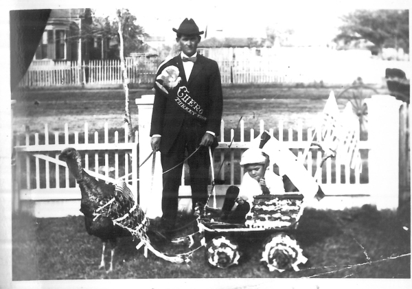Milton Brenner (standing) and Sid Daniels (in cart) in 1912 Turkey Trot parade, General Photographs Collection, MS 362