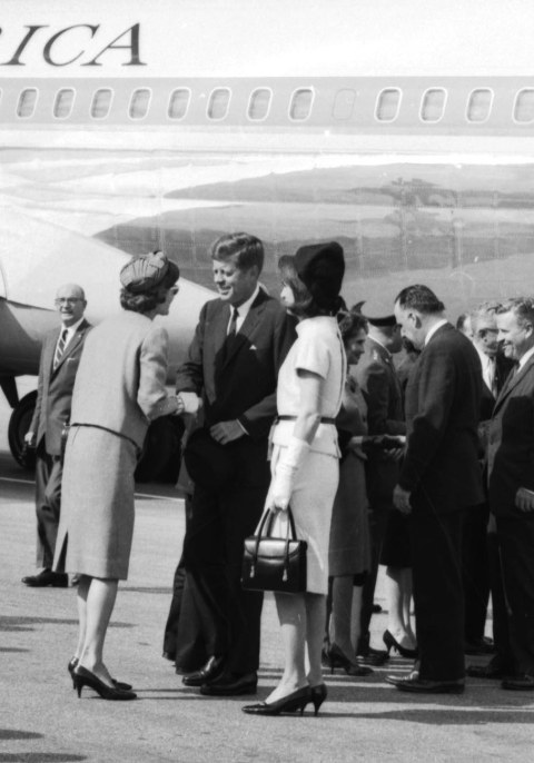 The President and First Lady are greeted at San Antonio International Airport shortly after their arrival.  Behind them are U.S. Rep. Henry B. Gonzalez and Senator Ralph Yarborough. (MS 360:  E-0009-140-B-03)