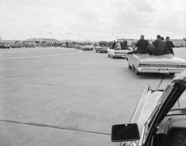The presidential motorcade begins the 16 mile trip through San Antonio to Brooks Air Force Base.   (MS 360:  E-0009-140-B-17)
