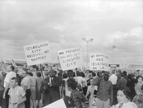 As the President leaves the airport, members of the San Antonio NAACP inform him of segregation policies in the city.  (MS 360:  E-0009-140-B-19)