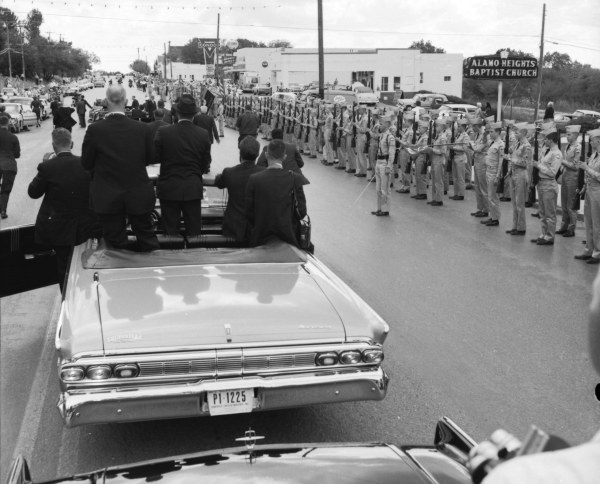 At the President's request, the motorcade stops briefly to receive a salute from the Texas Military Institute Cadet Corp.  (MS 360:  E-0009-140-C-07)