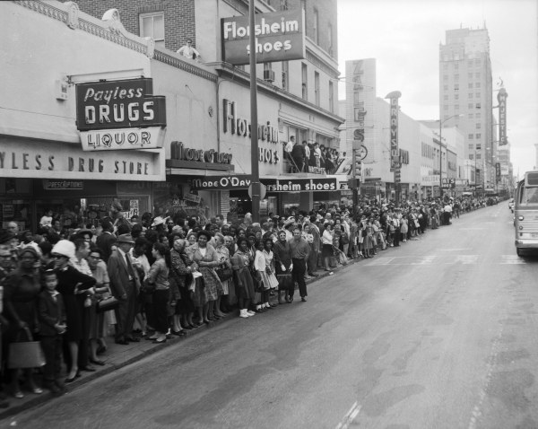 Crowded sidewalks in front of downtown stores on E. Houston Street.  (MS 360:  E-0009-140-D-04)
