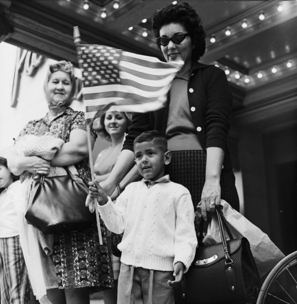 James Patrick Rodriguez and his mother wait for the President to pass in front of the Majestic Theater.  (MS 360:  E-0009-140-D-12)