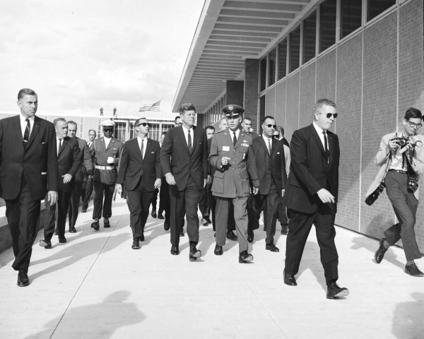 Maj. Gen. Theodore C. Bedwell, commander of the Aerospace Medical Division, escorts the President to see four airmen housed in a low-pressure altitude chamber in the Bioastronautic-Biodynamics Laboratory.   (MS 360:  E-0009-141-A-16)