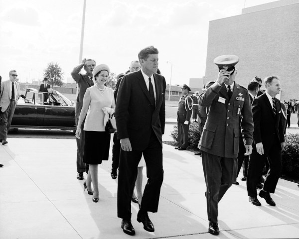 President Kennedy arrives at Brooks Air Force Base.  Behind him are Governor Connally, Lady Bird Johnson, Vice-President Johnson, and the First Lady (not visible).  (MS 360:  E-0009-140-C-06)
