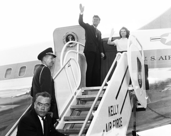 Before leaving for Houston, the Kennedys wave goodbye to a crowd of 17,000 Civil Service employees at Kelly Air Force Base.  (MS 360:  E-0009-141-D-6)