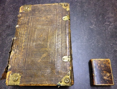 Postilla... (left) [uncataloged] and volume containing 22 prayer books bound together (right) [BX2170.N7 N68]