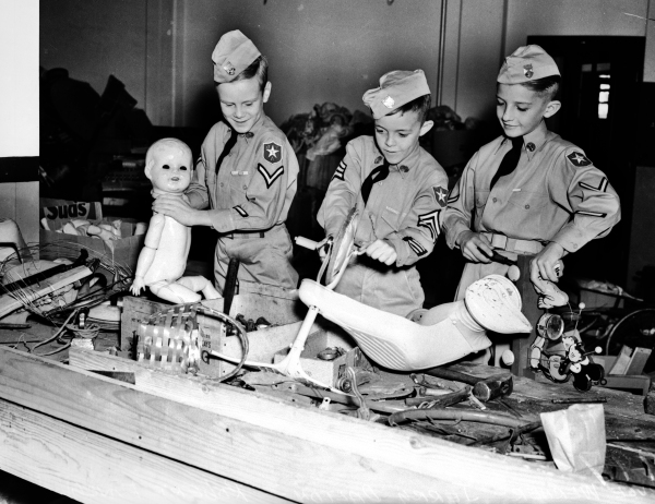 Members of the Junior Yanks of San Antonio help repair some of the toys they gathered for the San Antonio Light-San Antonio Fire Department toy drive, 1938.  (MS 359:  L-1997-A)
