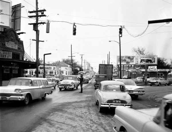 Officer directs traffic on icy Fredericksburg Road at Five Points, (San Antonio Express-News Collection, MS 360: E-0007-12-1)
