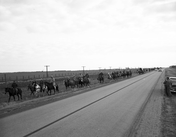 Outriders pass through prairie in Colorado County during the first day of the trail ride.  (MS 355:  Z-2475-B-59)