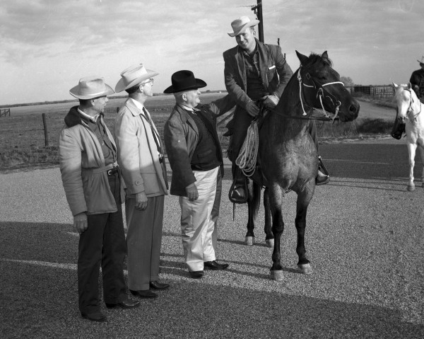 Lawmen--(l. to r.) Colorado County Sheriff J.O. Walker, Constable R.P. Simmons, and Texas Ranger Zeno Smith-- welcome Don Puckett and the trail riders to Rock Island.  (MS 355:  Z-2475-B-46)