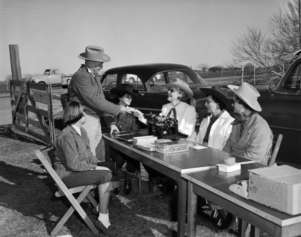 Members of the Old Spanish Trail Riders Association register participants at tables beside highway near Altair.  (MS 355:  Z-2475-B-55)