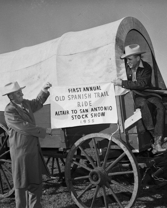 Advertising the upcoming event are Leon Kahanek, Hallettsville resident and chairman of the rodeo calf scramble committee, and Ed Johnson, president of the Old Spanish Trail Riders Association.  (MS 355:  Z-2475-B-58)
