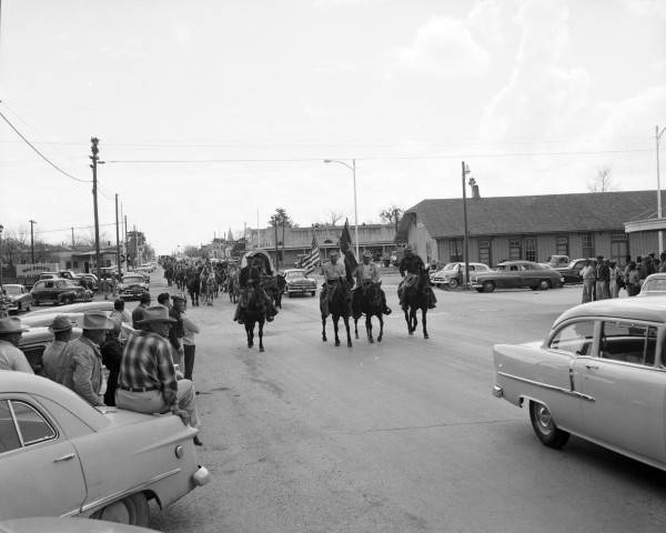 Residents gather on Avenue East to watch the trail drive pass through Shiner.  (MS 355:  Z-2475-B-68)