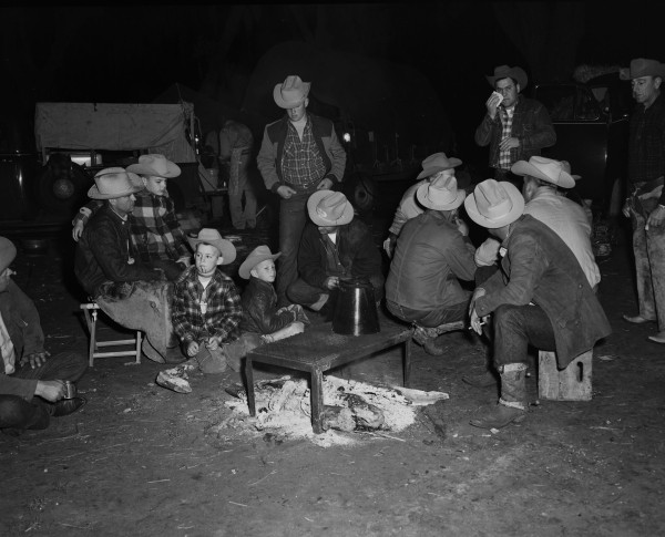 Riders gather around campfire before bedding down in the open.  (MS 355:  Z-2475-B-70)