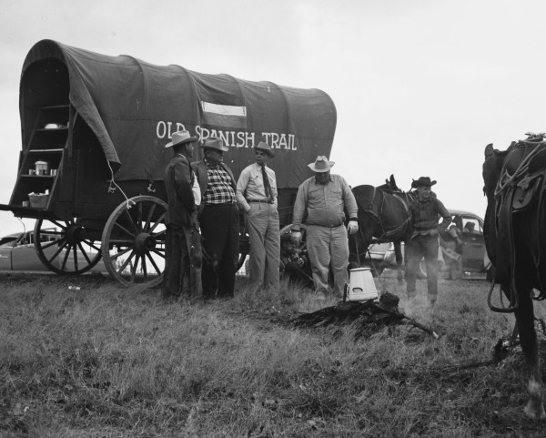 Trail riders take a break next to a chuck wagon.  (MS 355:  Z-2475-C-10)