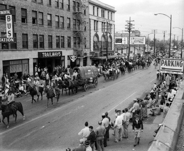 The day after they arrived in San Antonio, Old Spanish Trail Ride participants are among those in the Western Parade that officially opened the sixth annual stock show and rodeo..(MS 355:  Z-2475-D-101)