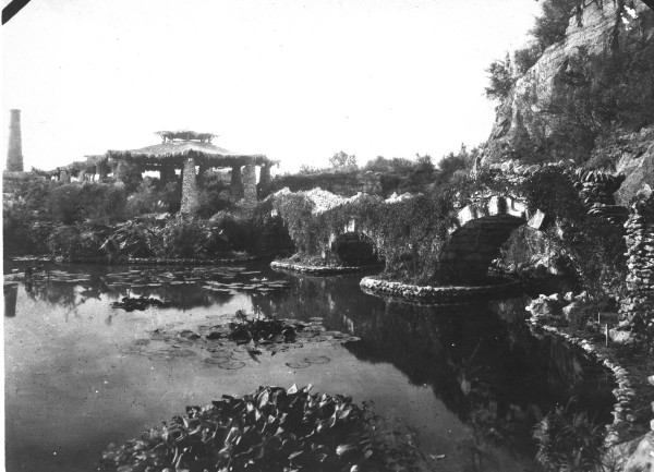 Bridge, built of stone from the site, providing access to the island, early 1920s.  (General Photograph Collection MS362:  092-0064)