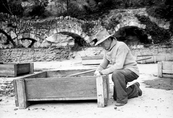 Hugo Gerhardt, the gardener for many years, repairs a planter in which the water lilies grow, February 1942.  (San Antonio Light Collection MS 359 L-2898-B)