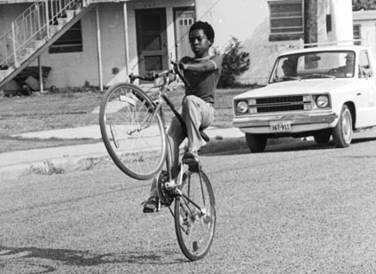 Joe Brown, trick bike rider, San Antonio, June 1982.  (San Antonio Express-News Photograph Collection MS 360:  E-0104-153)